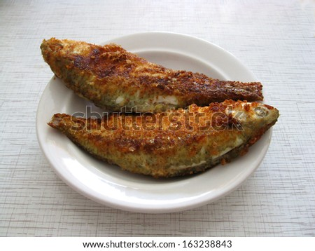 This is fired fish on white plate
