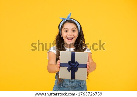 This is for you. Celebrate birthday. Kid birthday gift. Extra bonus. Grateful for good gift. Surprise and present box. Child smiling happy hold gift box. Kid girl delighted gift. Childrens day.