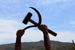 This is how the worker in the field showed the sickle-hammer figure, the symbol of communism.