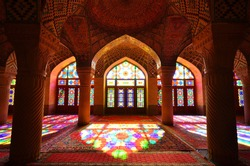 This is inside Nasir ol Molk mosque or pink mosque with low light , a very famous and beautiful traditional mosque in Shiraz , Iran