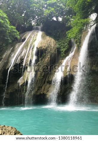 This is Mag-aso falls located in Oringao, Kabankalan City, Negros Occidental, Philippines. The waterfalls have awesome rock formation, blue-green water that give beauty to its wonderful panoramic view #1380118961