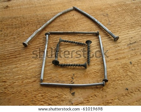 This is model of a house prepared  from nails
