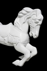 This is model of a running horse.  It's in the carousel style and it has been been isolated and put on a black background.