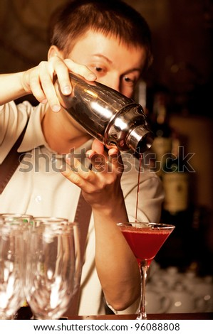 This is photograph of a barman at work