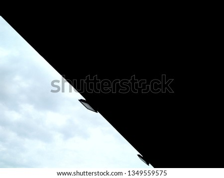 This is picture of black building and sky. This picture can be wallpaper.