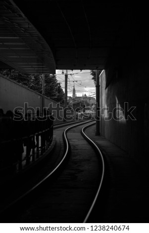 This is railway station in Budapest, Hungary. Black and white pic.