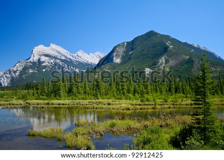 This is Rundle Mountain in behind of Sulphur Mountain in Banff National Park, Alberta, Canada.