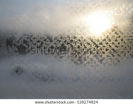 This is snow frosty pattern on winter window - stock photo