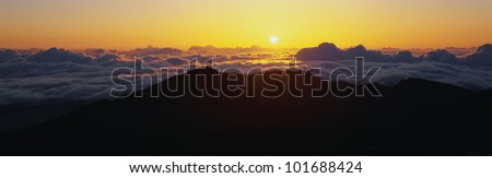 This is sunrise from Haleakala Volcano Summit located at Haleakala National Park. These are the cloud formations over the top of the volcano.