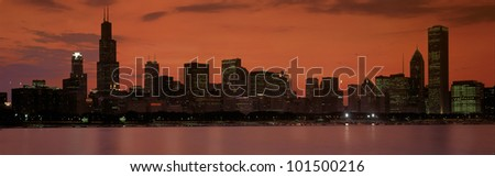 This is the complete Chicago skyline with the Chicago Harbor in the foreground. It is the view at sunset during summer.