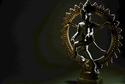 This is the figurine of dancing Shiva, one of the three principal gods of Hinduism. He is also known as