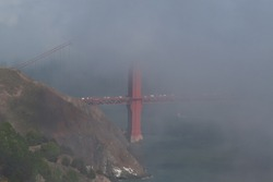 This is the Golden Gate Bridge in an Francisco, California, obscured by a thick blanket of fog.