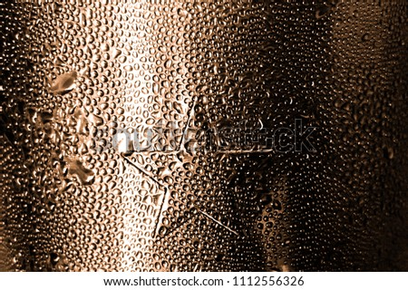 This is the nice metal material which show the reflection of light. This material also star shape stamped in symmetry, good proportion . The water sprayed on the metal make this pic look interesting.