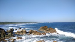 This is the photo when im travel to ranca buaya beach, i took this photo from the edge of cliff