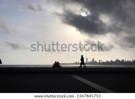 This is the picture captured at Marine Drive Mumbai (India) in the month of June. This picture reveals the sunset vibe of the amazingly beautiful place.