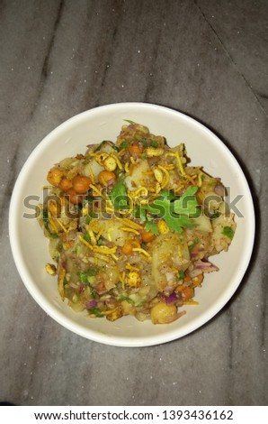 This is the picture of one of the famous potato chaat of kolkata. It is called 'Aluu Kabli'.