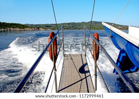 This is the stern ladder above the wakeful of the pleasure craft. #1172999461