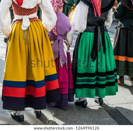 This is the tradicional women clothes in the north of Spain. They wear it in El Bollo Day Parade and Traditional Dancings. Long skirts in colours in woolen fabrics.The girl wears a Knitted shawl  #1264996126