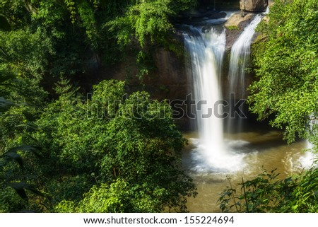 this is the waterfall in the national forest in thailand. this photo is taken on rainy season. the stream is very heavy and dangerous. #155224694