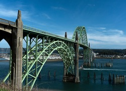 This is the Yaquina Bay Bridge in Newport, Oregon, which is on the Oregon Coast.  The picture was taken in March.  A marina is in the backround.