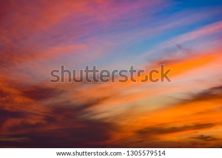 This is twilight sky or evening sky which is the time of sunset. The sky  is orange and blue colours. The cloud is a type of Cirrus or Cirrostratus cloud