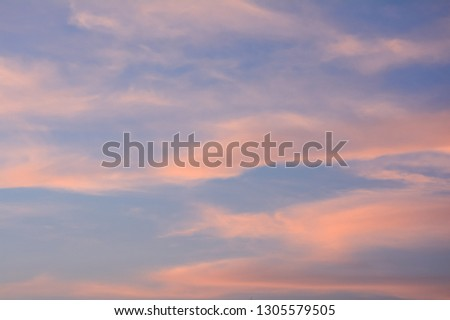 This is twilight sky or evening sky which is the time of sunset. The sky  is pink and blue colours. The most area of the picture is blue. The cloud is a type of Cirrus or Cirrostratus cloud