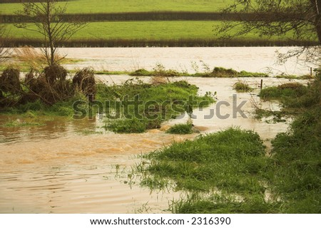 This is usually a small stream about a metre across but recent torrential rain has caused it to burst its banks and flood the adjoining area
