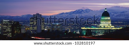 This is Utah\'s State Capitol, Great Salt Lake and Snow Capped Wasatch Mountains at sunset.