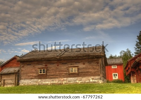 This is what a typical ancient finnish community used to look like. Shot taken from Stundars in Western Finland, a large open-air museum where culture and art is well preserved. /Old community - stock photo