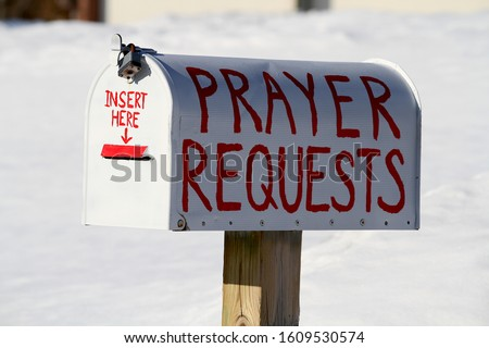 This mail box has the words prayer requests written on it.  There is a place in the front of the mail box for a person to insert their prayer.  It was photographed during the winter. Foto d'archivio ©
