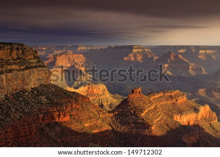 This majestic sunset photo at the South Rim of the Grand Canyon captures the amazing layers of landscape and quality of light.