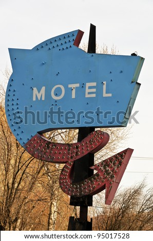 This old, rusty, faded motel sign must have been quite nice when it was new.