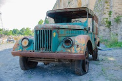 This orange and green vintage used as old and abandoned scrap car wreck or exterior decor, old and abandoned scrap car wreck or of this orange and green vintage used as exterior decor