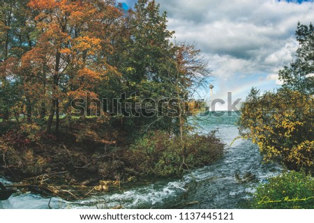 This painting like pic of fall colours near Niagara Falls has an alluring charm about it.The turbulence in the affluent stream feeding the fall waters, the falls mist & rainbow complete this panorama.