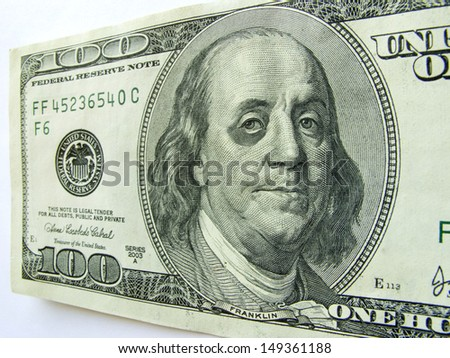 This photo illustration of Ben Franklin with a black eye on a one hundred dollar bill might illustrate a tough economy, inflation, unemployment or economic recession,or budget cuts etc.