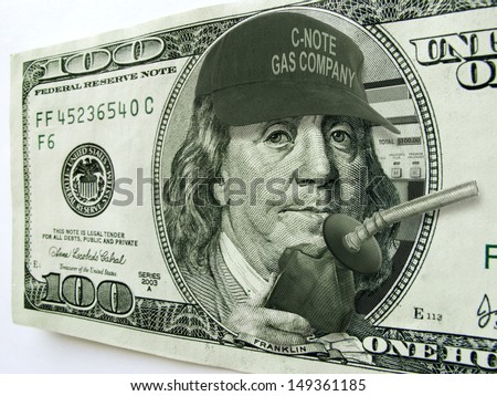 This photo illustration of Ben Franklin with hat and gas pump on a one hundred dollar bill illustrates the high cost of fuel and gas prices on the economy and the consumer.