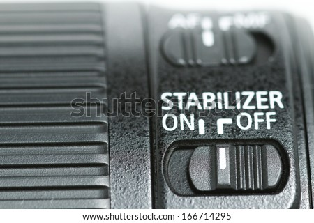 """This photo shows a closeup to a lens stabilizer button on the """"Off"""" position ."""