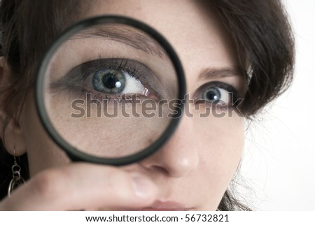 this photo shows a young girl with a magnifying glass