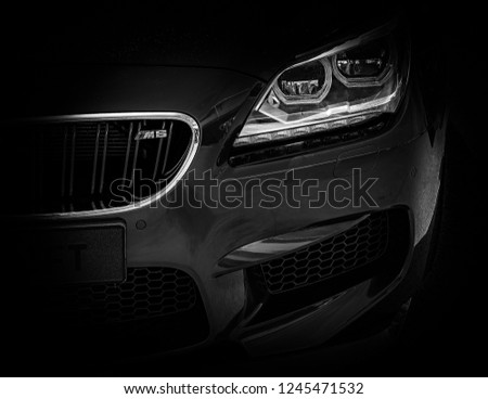 This photo was taken in Kettering, Northamptonshire / United Kingdom - May 6, 2018: The front light of a modern BMW M6 luxury car. #1245471532