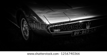 This photo was taken in Le Mans / France - July 7th, 2018 at Le Mans Classic: The front of a classic Italian Maserati Ghibli sports car. #1256740366