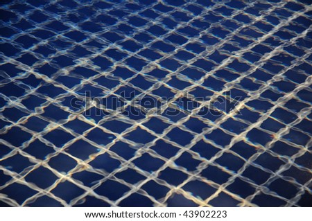 This photograph represent the most beautiful clear pool water reflecting.