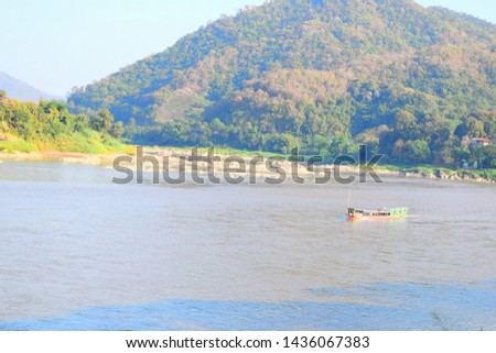 this pic a wood boat transfer the passengers in Mekong river during Thailand and Laos