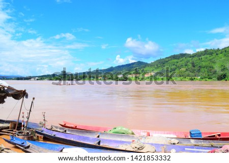 this pic show a local fisherman is fishing on his woodboat in mekong river Thailand