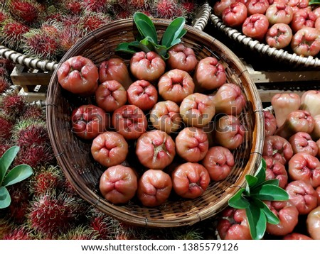 this pic show a lot of Rose apples on shelf in the market.