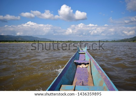 this pic show a part top head wooden boat of local  fisherman floating in river with blue sky and cloud, travel concept