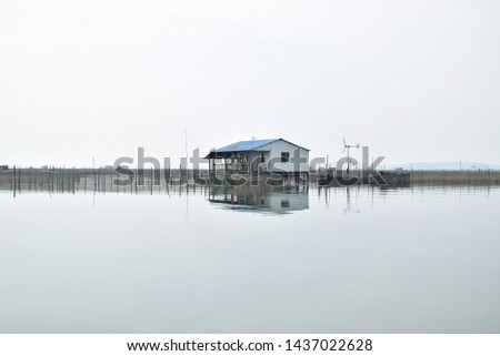 this pic show cottage in seafarm have many pen culture for rearing econmic fish, crabs or aquatic animal in China aquafarming concept.