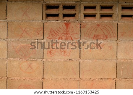 this pic show drawing by child on block wall at local countryside area Thailand