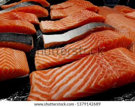 this pic show fillet a Salmon on black color background