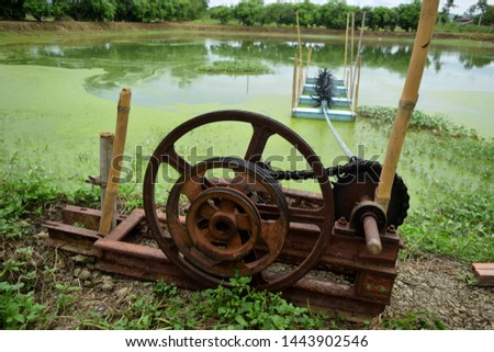 this pic show paddle wheel aerator in a aquaculture pond