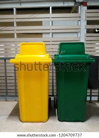 this pic show the both bins have green and yellow color for separated kind of garbage.